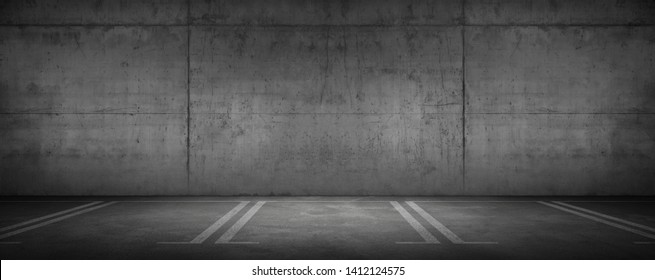 Wide Urban Concrete Garage Dark Wall and Car Parking Floor with Spot Light
