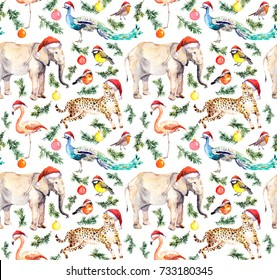 Wild animals and birds in red holiday hats with spruce christmas tree branches and decorative baubles. Seamless pattern for Christmas. Watercolor