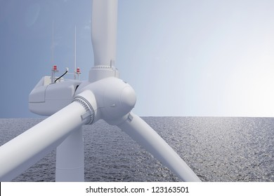 Windpower offshore with blue ocean and sunshine