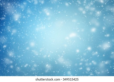 Winter background with flying snowflakes on  blue  - Shutterstock ID 349515425