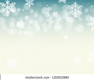 Winter bokeh background with snowflakes. Christmas bokeh holiday decoration.