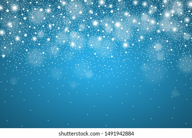 Winter glowing blue background of falling snow. Christmas and New Year card design. Realistic detailed snow fall abstract. Snowstorm, blizzard concept