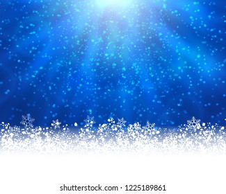 Winter holiday greeting card. Blue background with white snow at the bottom and light of shinning stat at the top. Raster version