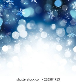 Winter Holiday Snow Background. Christmas Abstract Blue Defocused Backdrop with Snowflakes. Bokeh