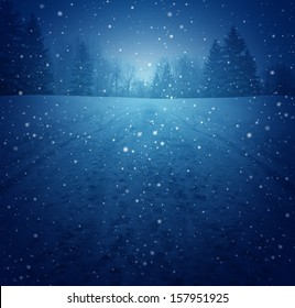 Winter landscape concept as a snowing blue background with a road in perspective with foot prints leading to a forest of trees as a festive seasonal icon of a tranquil and traditional holiday scene.
