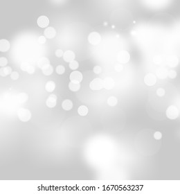 Winter light and white abstract bokeh on a bluish background