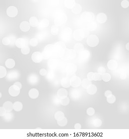 Winter light and white bokeh on a bluish background