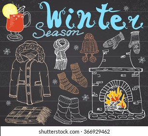 Winter season set doodles elements. Hand drawn collection with glass of hot wine, boots, clothes, fireplace, warm blanket, socks and hat, and lettering words. Drawing on chalkboard