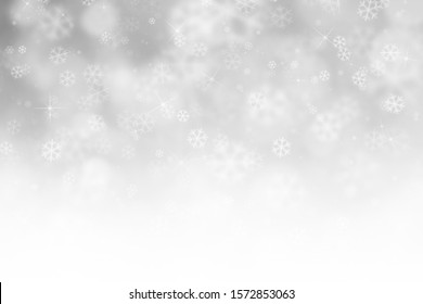 Winter sky background with snowflakes