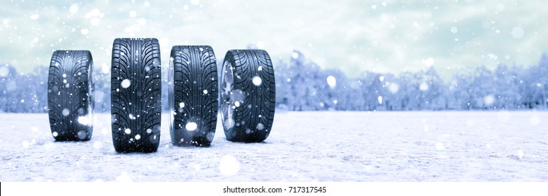Winter tires in the snow as panorama car safety concept (3D Rendering)