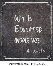 Wit is educated insolence - ancient Greek philosopher Aristotle quote written on framed chalkboard