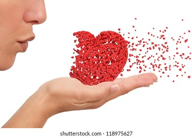 Woman blowing a heart made of little hearts spreading love like cupid isolated on a white background