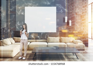Woman in modern living room interior with black marble walls, a wooden floor and a beige sofa with a poster hanging above it. 3d rendering mock up toned image double exposure