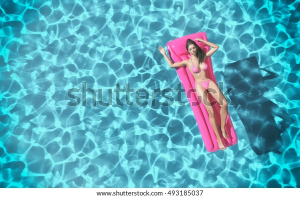 Woman relaxing on pink water mattress in the pool. This is a 3d render illustration