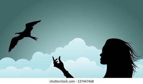 Woman releasing bird profile silhouette. jpg