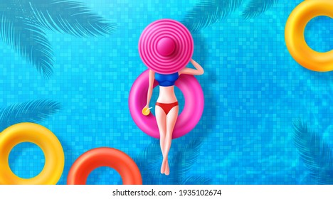 Women Floating In Swimming Pool With Big Hat