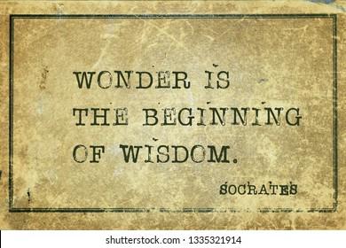 Wonder is the beginning of wisdom - ancient Greek philosopher Socrates quote printed on grunge vintage cardboard