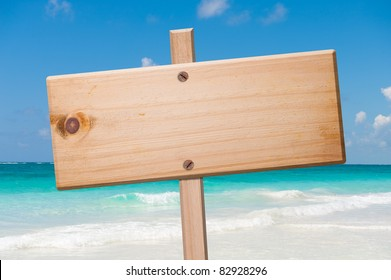 Wood sign in the beach, with clipping path.