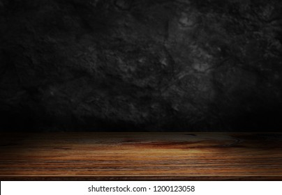 Wood table and dark wood wall background