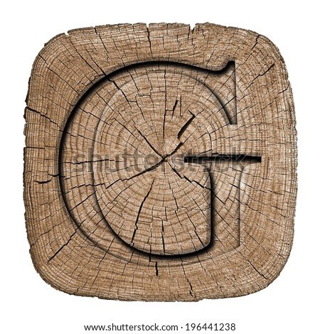 wooden alphabet block letter g font carved in wood showing growth rings