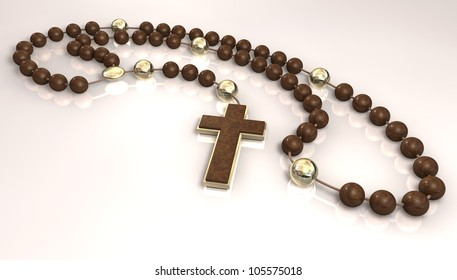A wooden beaded rosary interspersed with gold beads and a wood and gold crucifix
