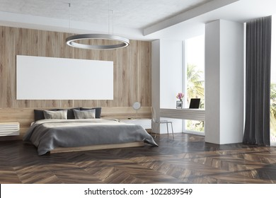 Wooden bedroom interior with a wooden floor, a master bed with bedside tables and a long horizontal poster hanging above it. A side view. 3d rendering mock up