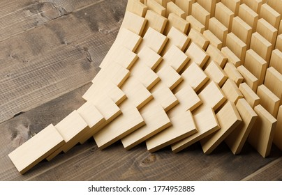 Wooden domino stones pyramid on wood floor falling over, chain reaction or multiplication effect concept, 3D illustration
