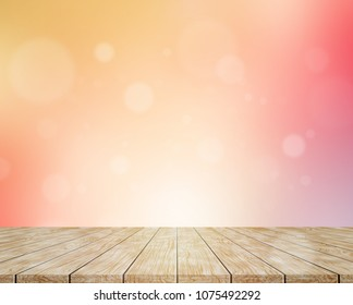 Wooden floor and blur colorful background with abstract bokeh lights