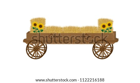 Wooden hay wagon cross-country jump with decorative wagon wheels, floral appliques, sunflowers, and bales of hay.
