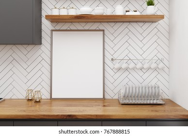 Wooden kitchen table with a framed vertical poster standing in a white wooden kitchen interior with a cup rack. 3d rendering mock up