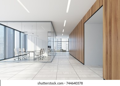 Wooden office lobby with a white wooden floor, panoramic windows, a glass conference room and several soft armchairs. 3d rendering