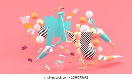 Wooden puppet Painting amidst colored tubes and colorful balls on a pink background.-3d render.