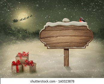 Wooden sign and bird in snow
