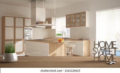 Wooden table, desk or shelf with potted grass plant, house keys and 3D letters home sweet home, over minimalist white kitchen, architecture interior design, copy space background, 3d illustration