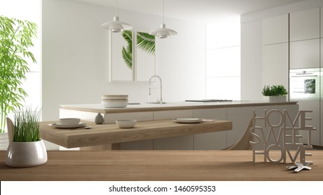 Wooden table, desk or shelf with potted grass plant, house keys and 3D letters making the words home sweet home, over modern white kitchen, interior design, blur background, 3d illustration