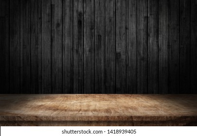 Wooden table on black wall in dark room background 3d illustration