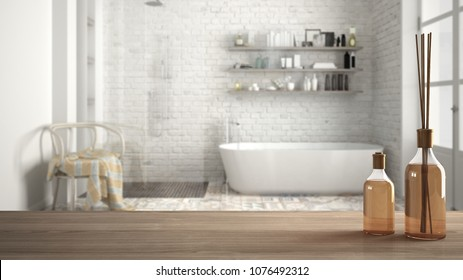 Wooden table top or shelf with aromatic sticks bottles over blurred classic bathroom with bathtub, white architecture interior design, 3d illustration