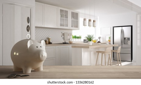 Wooden table top or shelf with white piggy bank with coins, scandinavian white and wooden kitchen, expensive home interior design, renovation restructuring concept architecture, 3d illustration
