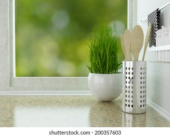 Wooden utensils on the marble worktop. White kitchen design.