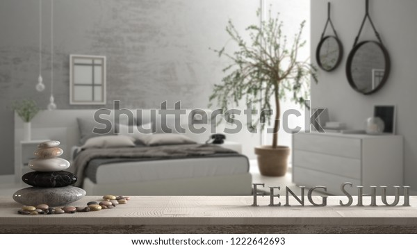 Wooden vintage table shelf with pebble balance and 3d letters making the word feng shui over blurred bedroom with window, chest of drawer, big olive tree, zen concept interior design, 3d illustration