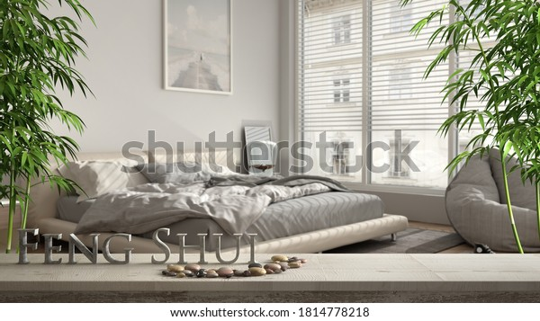 Wooden vintage table shelf with pebble balance and 3d letters making the word feng shui over blurred modern bedroom with big window and double bed, zen concept interior design, 3d illustration