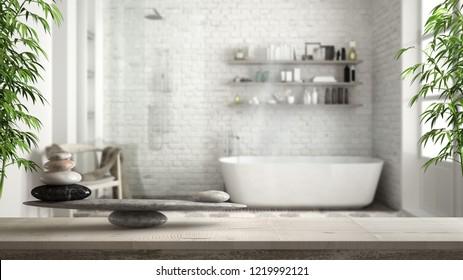 Wooden vintage table or shelf with stone balance, over blurred vintage bathroom with bathtub and shower, feng shui, zen concept architecture interior design, 3d illustration