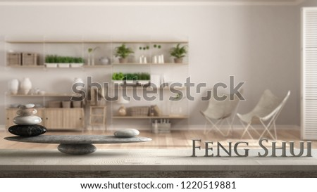 Wooden Vintage Table Shelf With Stone Balance And 3d Letters Making The Word Feng Shui Over