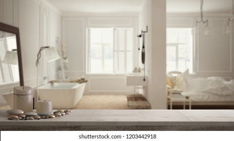 Wooden vintage table top or shelf with candles and pebbles, zen mood, over blurred luxury bedroom with bathroom in scandinavian style, minimal architecture interior design, 3d illustration