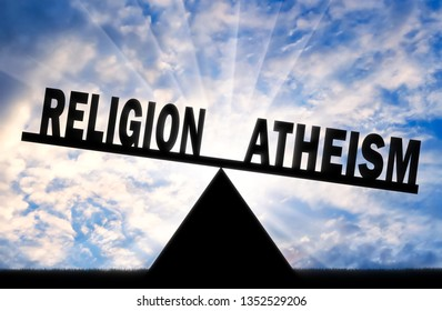 Word atheism is more powerful than the word religion on the scales. Concept of atheism