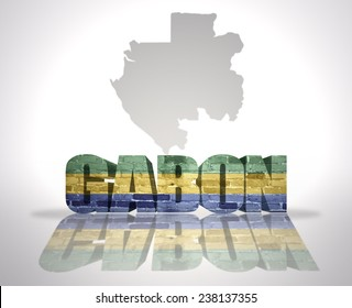Word Gabon with National Flag near map of Gabon