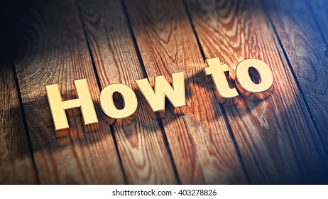 "The word ""How To"" is lined with gold letters on wooden planks. 3D illustration picture"