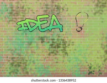 The word idea written in a graffiti on a red brick wall and a light bulb drawn.