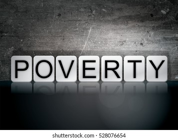 """The word """"Poverty"""" written in white tiles against a dark vintage grunge background."""