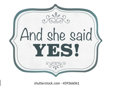 Word quotes of HE ASKED, SHE SAID YES on card board